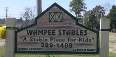 Roadside sign at Wampee Stables a Myrtle Beach horseback riding attraction.
